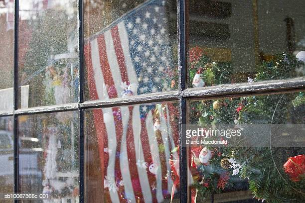 usa, massachusetts, cape cod, window display with american flag and christmas tree , view through window - patriotic christmas stock pictures, royalty-free photos & images