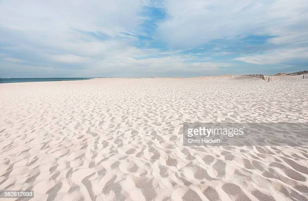 usa, massachusetts, chatham, lighthouse beach, footprints on beach - 砂 ストックフォトと画像
