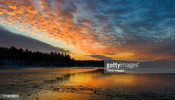 usa, massachusetts, concord, walden pond, sunset - walden pond stock pictures, royalty-free photos & images