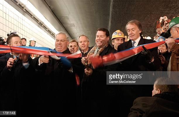 Massachusetts dignitaries including Boston Mayor Tom Menino and Massachusetts Turnpike Authority Chairman Matthew J Amorello cut a ribbon during a...