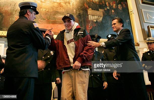 Massachusetts Firefighter of the Year award ceremony at Faneuil Hall Chelmsford Fire Department Captain James Durkin gives a hand along with Governor...