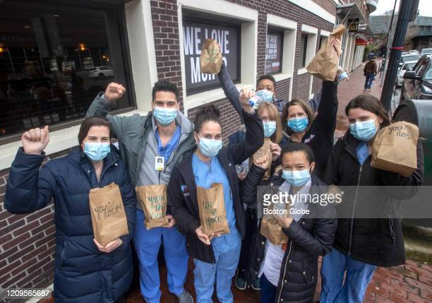 Massachusetts General Hospital staff pickup free sandwiches courtesy of restaurant Harvard Gardens which prepared 1000 paper bag lunches to support...
