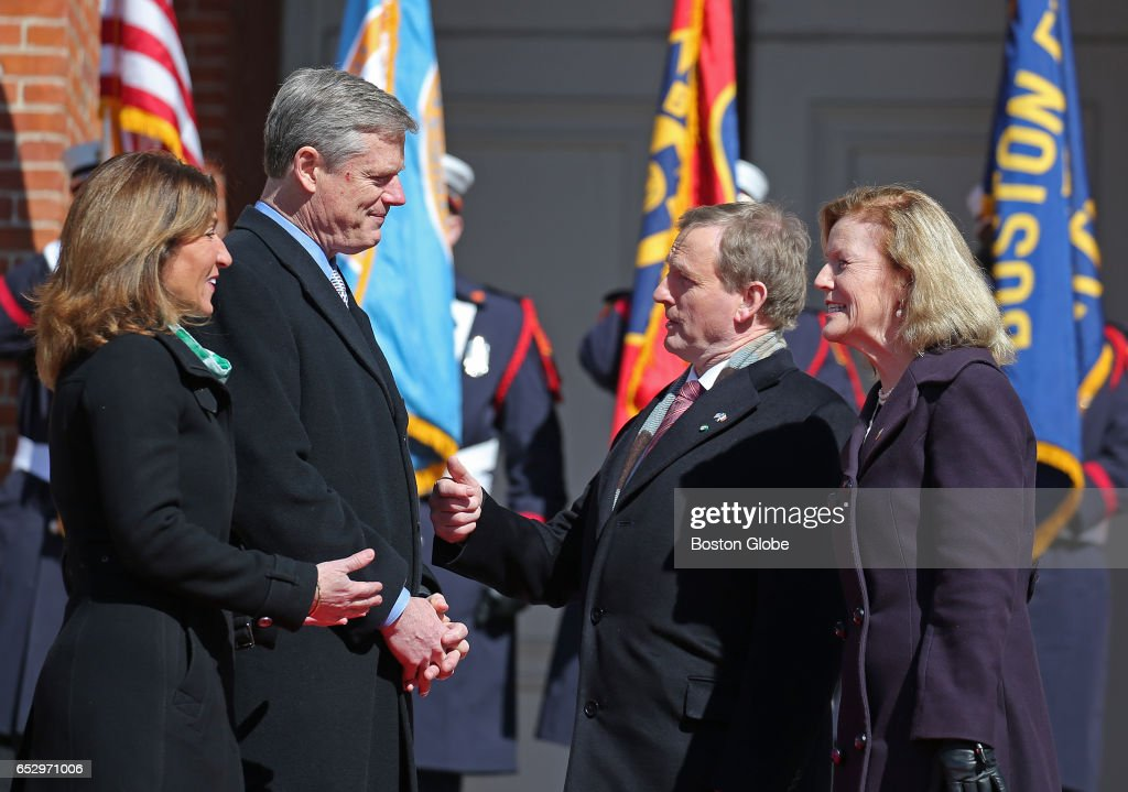Massachusetts Gov. Charlie Baker and Lt. Gov. Karyn Polito greet Irish Prime Minister Taoiseach Enda Kenny, second from right, and Irish Ambassador to the United States Anne Anderson, far right, on the State House Steps in Boston on Mar. 13, 2017, accompanied by pipes and drums.