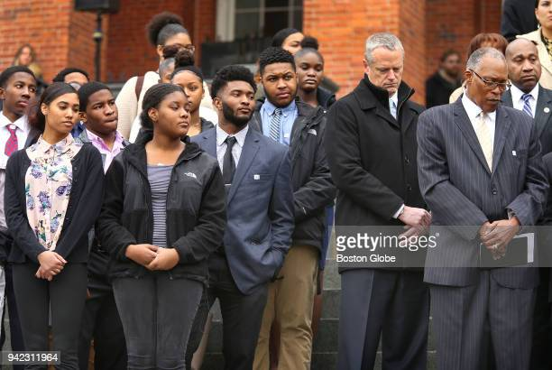 Massachusetts Governor Charlie Baker center and Rev Conley Hughes right of the Concord Baptist Church in Milton join members of the black and latino...