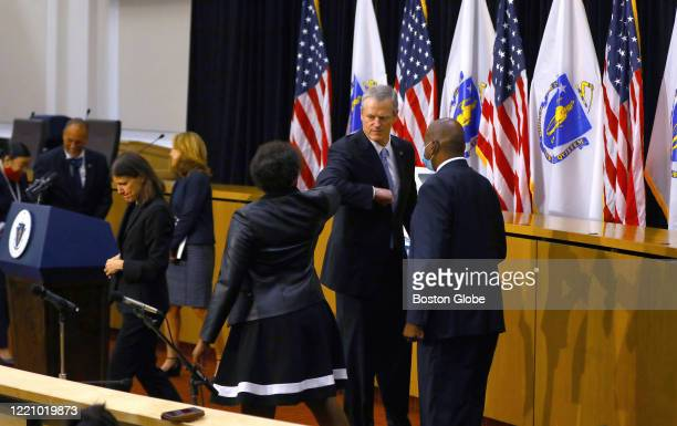Massachusetts Governor Charlie Baker gives an elbow bump to Rep. Nika Elugardo, left, and Rep. Russell E. Holmes after Baker gave a daily press...