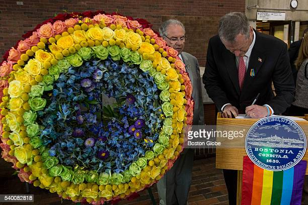 Massachusetts Governor Charlie Baker signs a condolences book after taking part in a vigil for victims of the mass shooting at an Orlando nightclub...