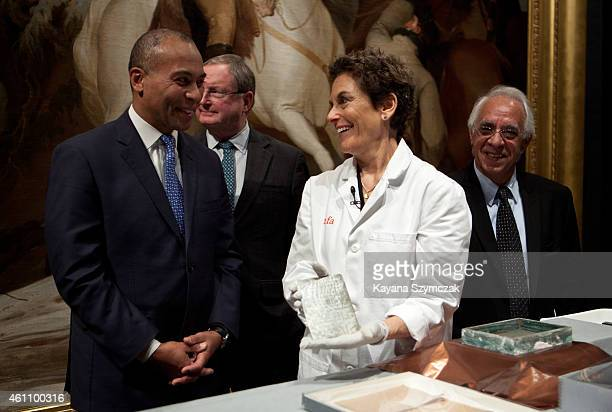 Massachusetts Governor Deval Patrick speaks with Pam Hatchfield, Head of Objects Conservation at the Museum of Fine Arts, Boston, as she displays a...