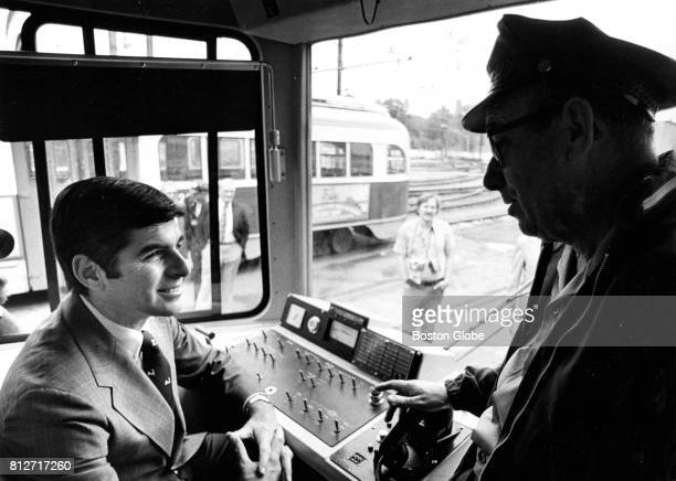 Massachusetts Governor Michael Dukakis chats with MBTA operator James Carton Sr of Newton the man who drives him to work each day on a new Riverside...