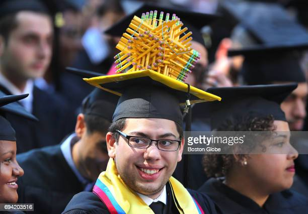 Massachusetts Institute of Technology Graduate student Nicolas Gomez who received a degree in civil engineering wears a pencil sphere on his cap...