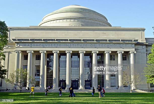 Massachusetts Institute of Technology students play football outside the Maclaurin building October 10 2003 in Cambridge Massachusetts