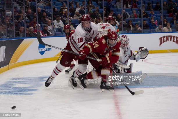 Massachusetts Minutemen Defenseman Cale Makar and Denver Pioneers Forward Jarid Lukosevicius battle for the puck during the second period of the game...