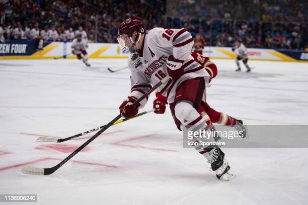 Massachusetts Minutemen Defenseman Cale Makar skates with the puck during the second period of the NCAA Hockey Frozen Four semi-final game between...