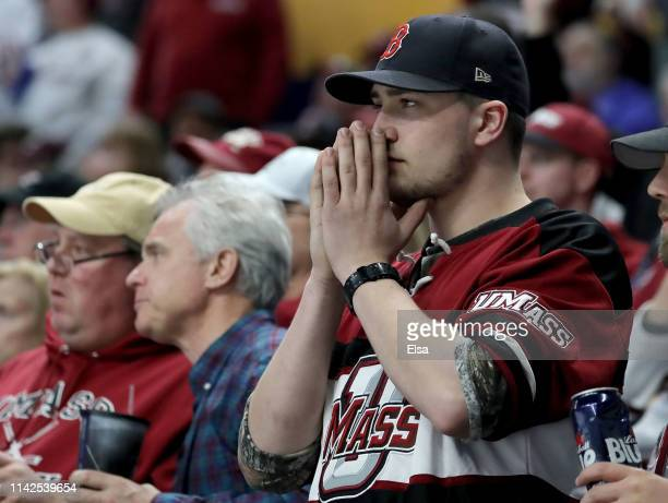 Massachusetts Minutemen fan reacts to a call in the second period against the MinnesotaDuluth Bulldogs during the 2019 NCAA Frozen Four the...