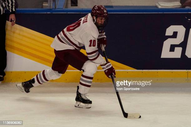 Massachusetts Minutemen Forward Jack Suter skates with the puck during the first period of the NCAA Frozen Four semi-final game between the...