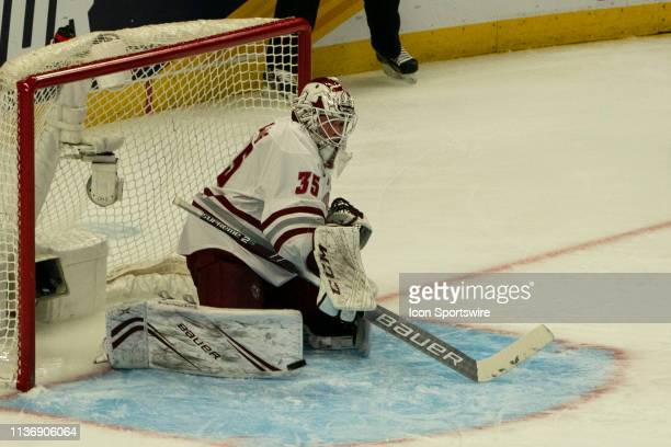 Massachusetts Minutemen Goaltender Flip Lindberg makes a pad save during the first period of the NCAA Frozen Four semi-final game between the...