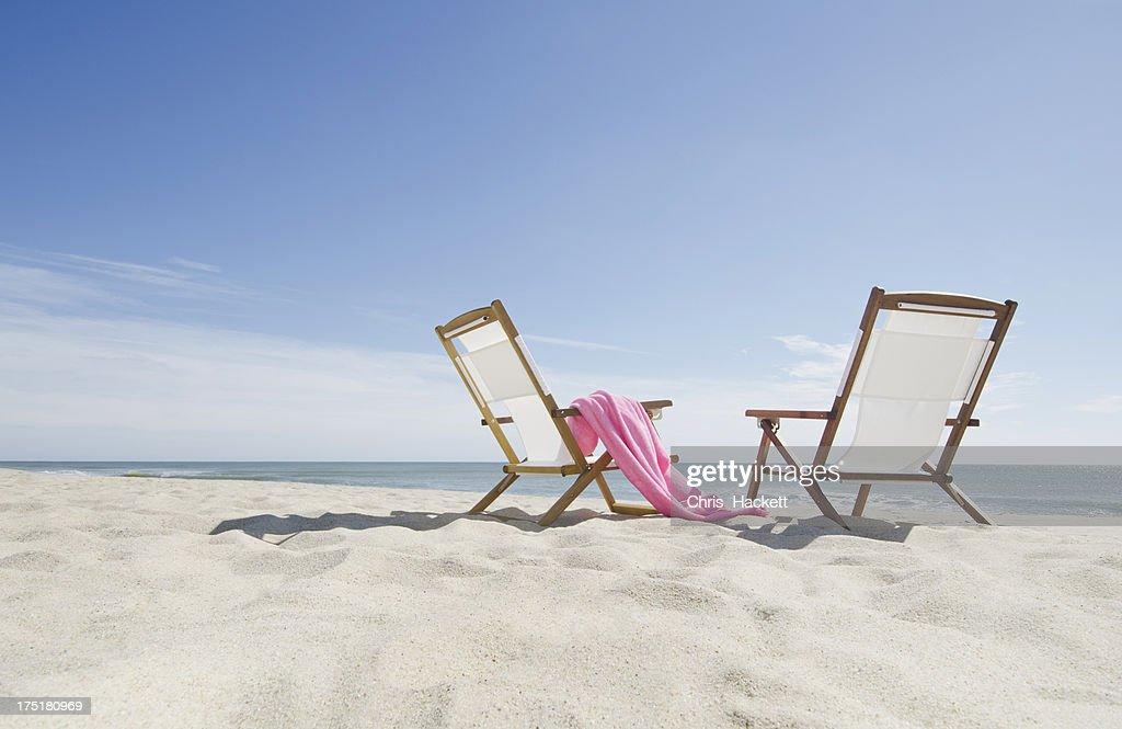 USA, Massachusetts, Nantucket, empty lounge chairs on sandy beach : Stock Photo