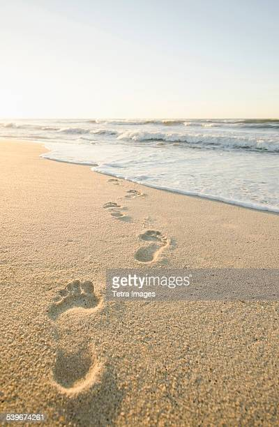 USA, Massachusetts, Nantucket, Footprints on beach