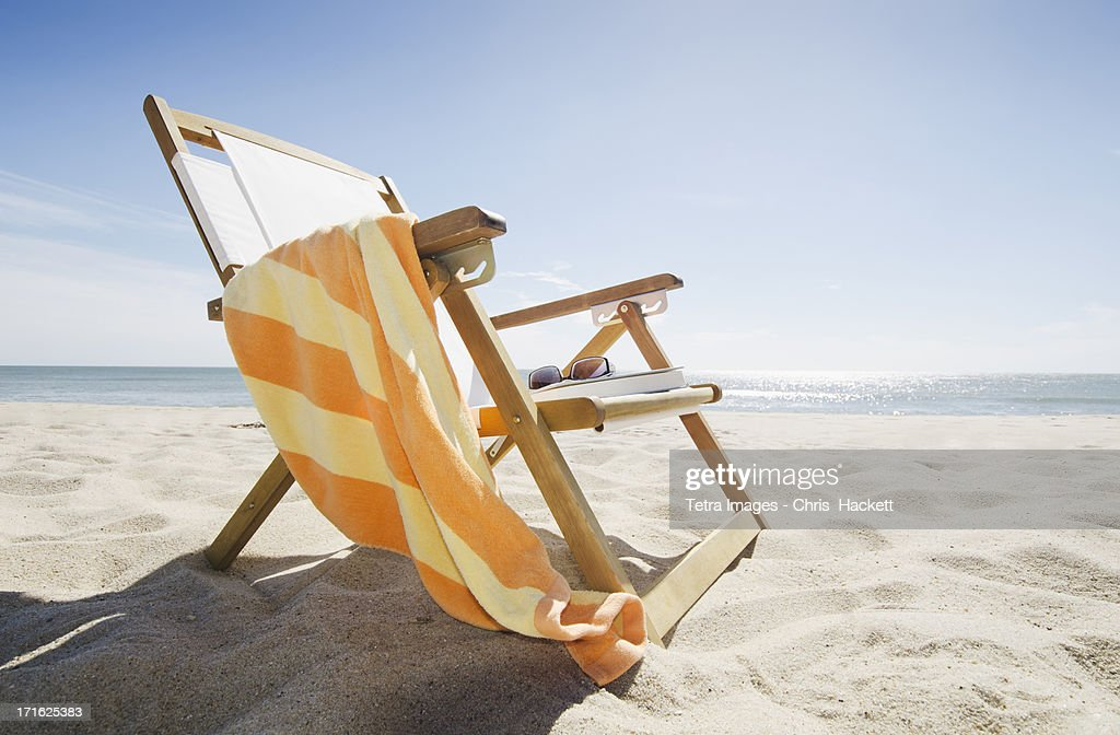 USA, Massachusetts, Nantucket Island, Sun chair on sandy beach : Stock Photo