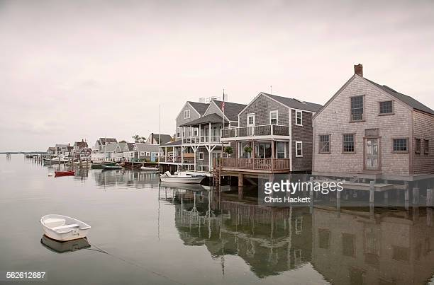 usa, massachusetts, nantucket, old north wharf, boats and stilt houses - nantucket stock pictures, royalty-free photos & images