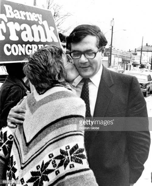 Massachusetts Representative Barney Frank gets a kiss from one of his campaign workers Louise Landy at the voting place at the Hyde School in Newton...