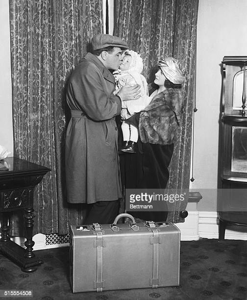 Ruth Prepares For Departure To Southland Photo shows German Herman Ruth more popularly known as the Babe kissing Mrs Ruth and their baby Dorothy as...