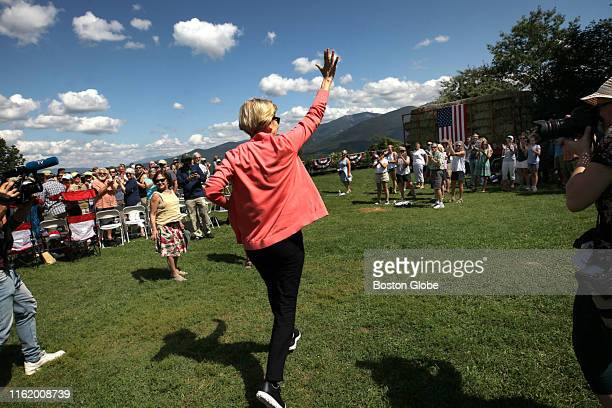 Massachusetts Senator Elizabeth Warren runs into the crowd at the beginning of her 122nd town hall of the Democratic presidential primary at Toad...