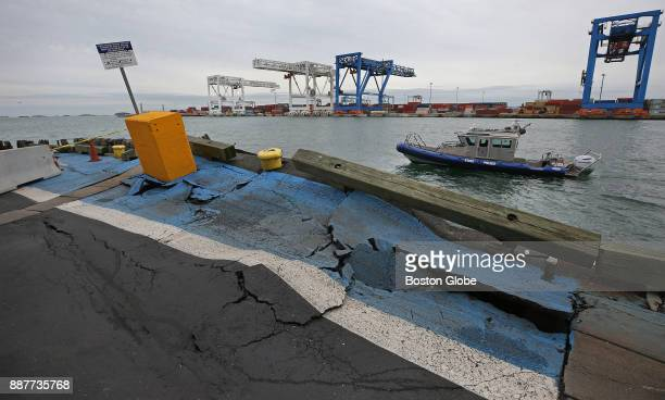 Massachusetts State Police boat passes a pier damaged by the container ship Helsinki Bridge which broke loose from its mooring at the Paul J Conley...