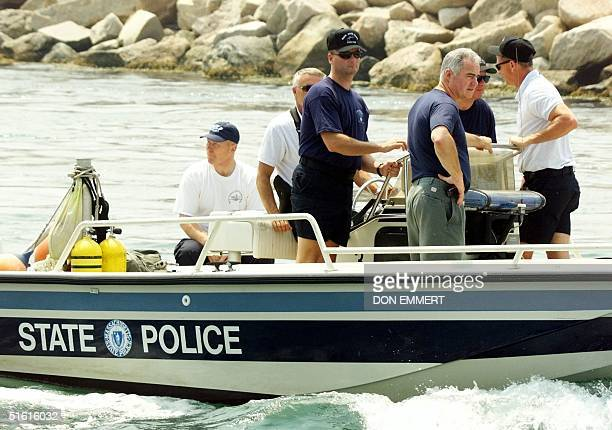 Massachusetts State Police divers leave Menemsha on Martha's Vineyard 19 July 1999 in a stepped up search for the wreckage of the plane carrying John...