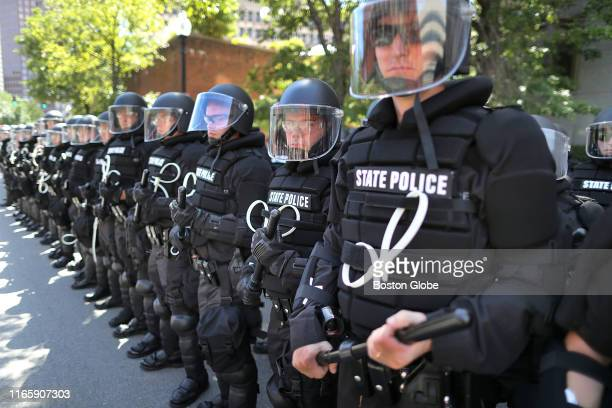 Massachusetts State Police in riot gear line Congress Street as the Straight Pride Parade makes its way to Boston City Hall Plaza on Aug 31 2019 In...