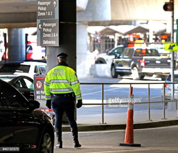 Massachusetts State Police officer stands by a construction site at Terminal C at Logan Airport in Boston on March 27 2018 Revelations about an...