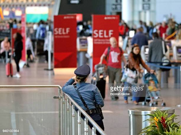 Massachusetts State Police officer watches over Terminal A at Logan Airport in Boston on March 27 2018 Revelations about an alleged overtime scam a...
