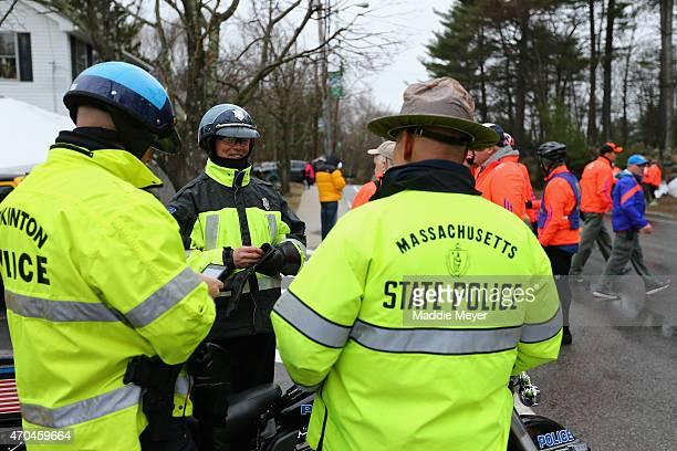 Massachusetts State Police stand near the starting line before the 119th Boston Marathon on April 20 2015 in Hopkinton Massachusetts