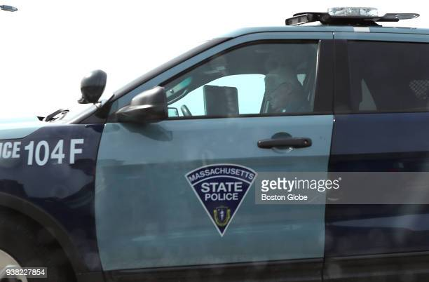 Massachusetts State Police Troop F SUV sits parked with a trooper inside on the ramp leading to Terminal A at Logan Airport in Boston on March 23...