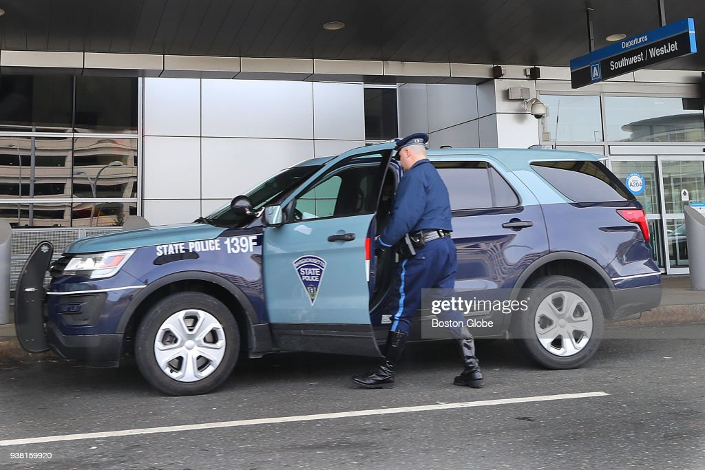 A Massachusetts State Police trooper gets into a Troop F SUV