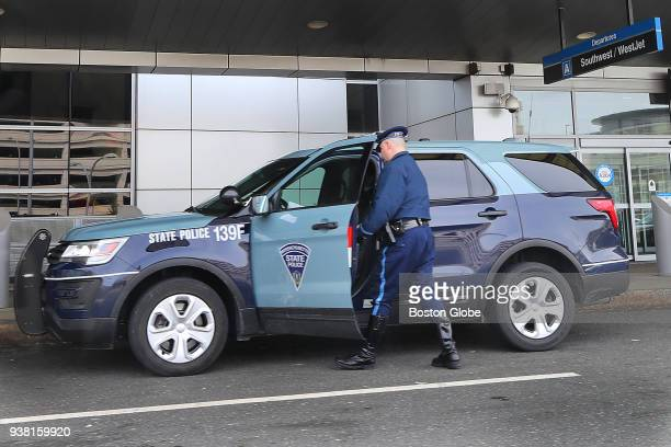 Massachusetts State Police trooper gets into a Troop F SUV in front of Terminal A at Logan Airport in Boston on March 23 2018 Revelations about an...