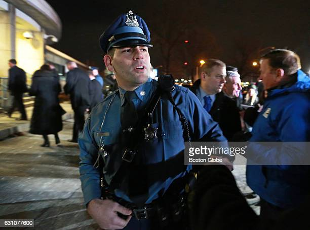 Massachusetts State Trooper Joseph Merrick who arrested federal prison escapee James Morales earlier in the day in Somerville is pictured after a...