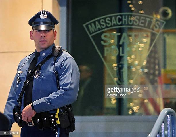 Massachusetts State Trooper Joseph Merrick who arrested federal prison escapee James Morales earlier in the day in Somerville is pictured as he walks...