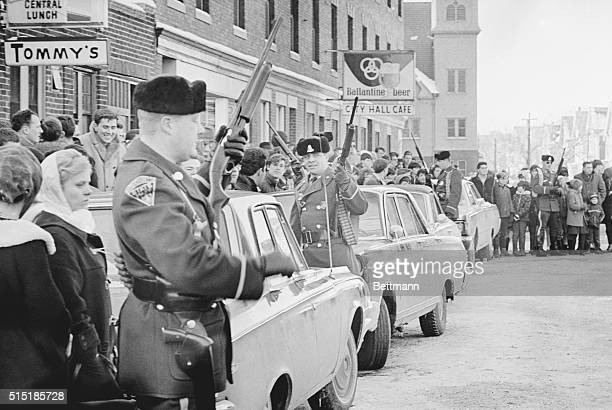 Massachusetts state troopers brandish shotguns as they keep a crowd of some 2000 curious onlookers under control across the street from the Lynn...