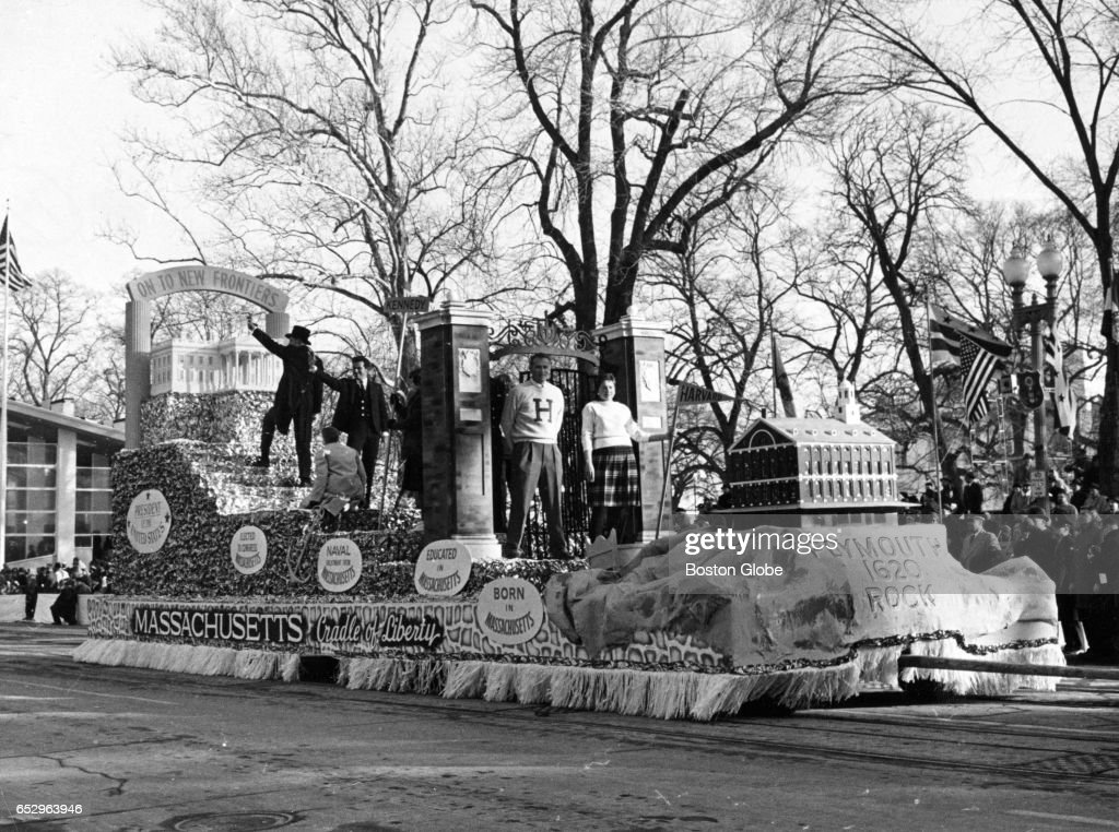 A Massachusetts-themed float passes by the White House on Pennsylvania Avenue during the parade for President John F. Kennedy's inauguration in Washington, D.C. on Jan. 20, 1961.