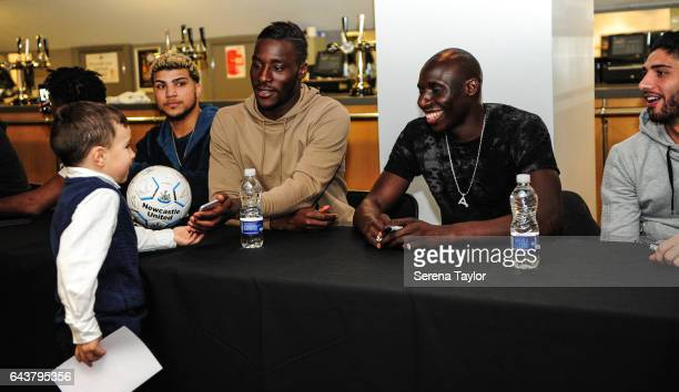 Massadio Haidara hands a signed ball back to a fan during the Junior Magpies signing session also seen is DeAndre Yedlin Mohamed Diame and Achraf...