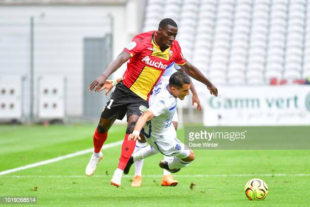 Massadio Haidara of Lens and Ahmed Kashi of Troyes during the French Ligue 2 match between RC Lens and Troyes at Stade BollaertDelelis on August 18...