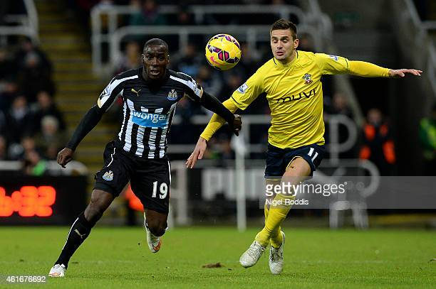 Massadio Haidara of Newcastle United battles for the ball with Dusan Tadic of Southampton during the Barclays Premier League match between Newcastle...