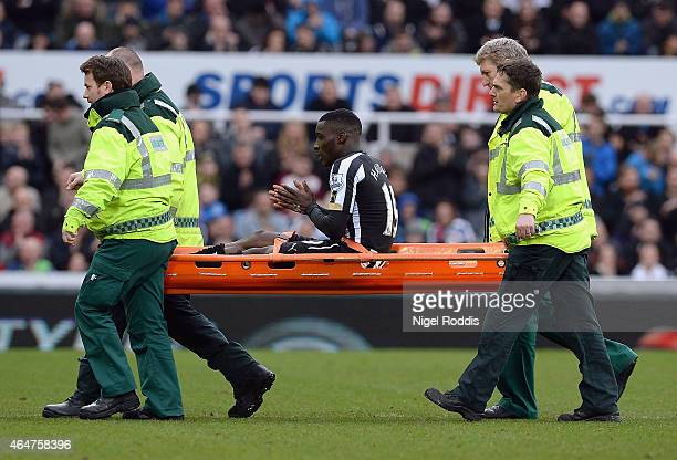 Massadio Haidara of Newcastle United is stretchered off injured during the Barclays Premier League match between Newcastle United and Aston Villa at...