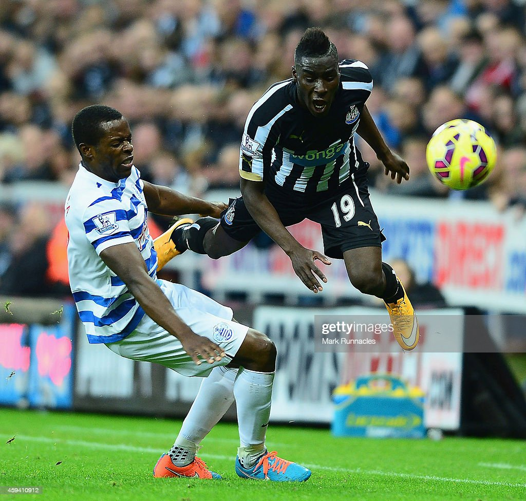 Massadio Haidara of Newcastle United is tackled by Nedum Onuoha of QPR during the Barclays Premier League match between Newcastle United and Queens Park Rangers at St James' Park on November 22, 2014 in Newcastle upon Tyne, England.