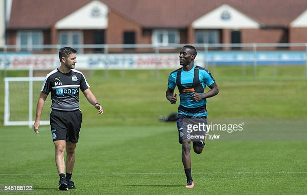 Massadio Haidara runs on the pitch under the watchful eye of Physiotherapist Michael Harding during the Newcastle United Training session at The...