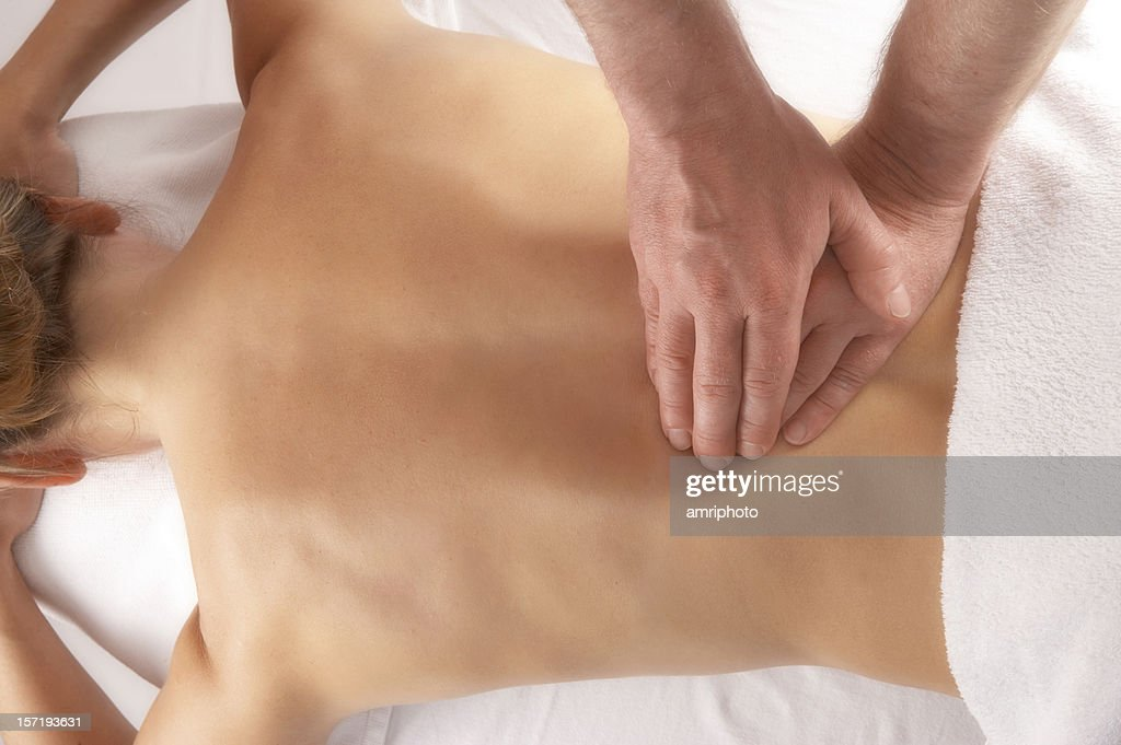 massage of the lower back : Stock Photo