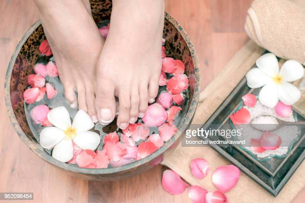 Massage of woman's foot in spa salon - Beauty treatment conc