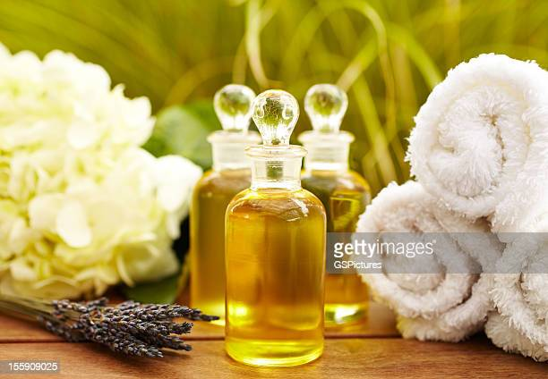 massage oil bottles at spa - toiletries stock pictures, royalty-free photos & images