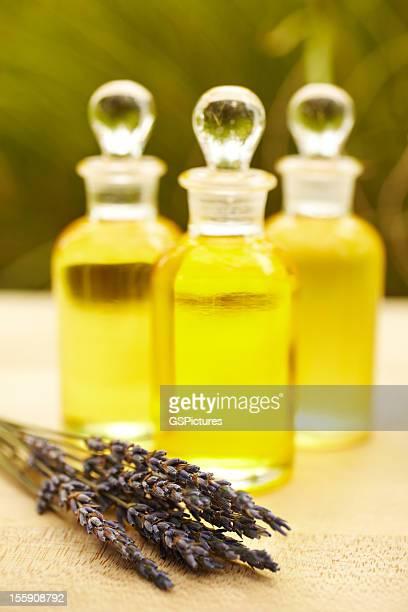 Massage oil bottles at spa with lavender