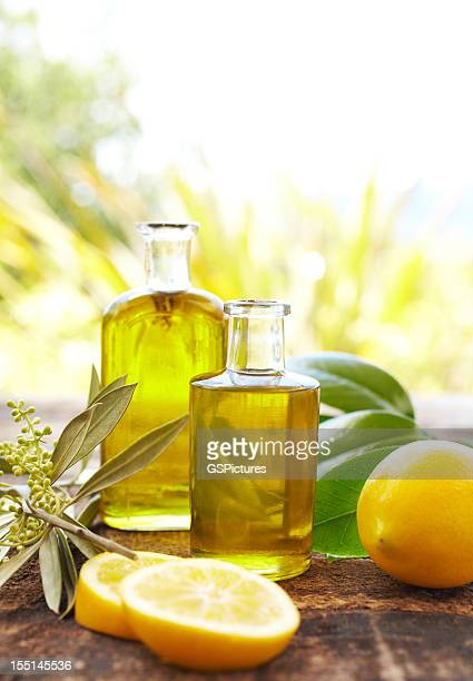 Massage oil bottles with lemons and leaves at spa outdoors